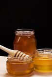 Glass pot of honey Royalty Free Stock Photos