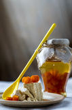 Glass pot of orange jam and halva with citron Stock Photo