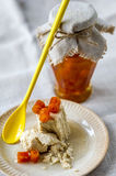 Glass pot of orange jam and halva with citron Stock Photography
