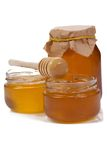 Glass pots of honey Royalty Free Stock Photography