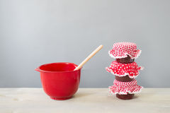Glass pots jam and red bowl Royalty Free Stock Images