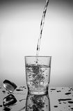 In a glass pour water Stock Photos