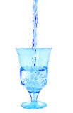 In glass poured of clean water. On a white background royalty free stock photography
