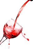 Glass of pouring red wine Royalty Free Stock Photo