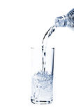 Glass of pouring water Royalty Free Stock Photos