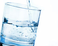 Glass with pouring water Royalty Free Stock Image