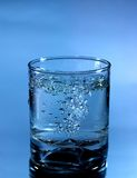 Glass of pouring water Royalty Free Stock Image