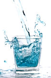 Glass of pouring water Stock Images