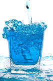 Glass of pouring water Stock Photography