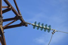 Glass prefabricated high voltage insulators on poles high-voltag royalty free stock images