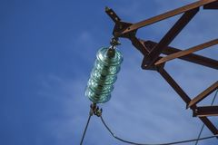 Glass prefabricated high voltage insulators on poles high-voltag stock photo