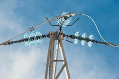 Glass prefabricated high voltage insulators on poles high-voltage power lines Royalty Free Stock Photos