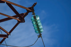 Glass prefabricated high voltage insulators on poles high-voltage power lines. Electrical industry Stock Image