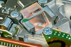 Glass prism in DVD drive. Glass prism of the DVD drive laser head macro Royalty Free Stock Images