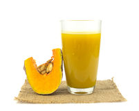 Glass of pumpkin juice on white Royalty Free Stock Photography