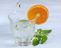 Fresh drink pouring Royalty Free Stock Photos