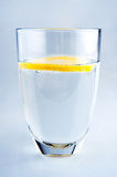 Glass of pure mineral water with lemon. Glass of pure mineral water with ripe lemon Stock Images