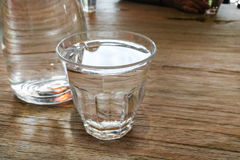 Glass of pure purified mineral drinking water on table Stock Image