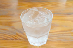 Glass of pure water and ice cube Royalty Free Stock Photo