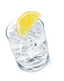 Glass of pure water with ice cubes and lemon slice Stock Images