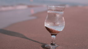 A glass of pure water on the tropical beach. HD stock video