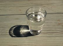 Glass of pure water on wooden table Stock Photos