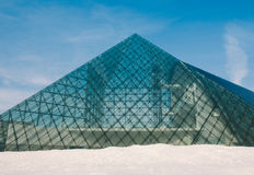 Glass pyramid architecture. SAPPORO, JAPAN - FEBRUARY 2015: The symbol of Moerenuma park, the glass pyramid Hidamari, on February 5 in Sapporo. The glass pyramid Stock Photography