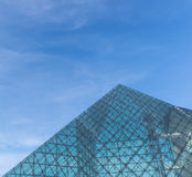 Glass pyramid architecture. SAPPORO, JAPAN - FEBRUARY 2015: The symbol of Moerenuma park, the glass pyramid Hidamari, on February 5 in Sapporo. The glass pyramid Royalty Free Stock Images