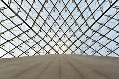 Glass pyramid in the Louvre Stock Images