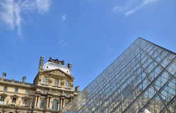 Glass pyramid at Louvre museum in Paris Stock Photos