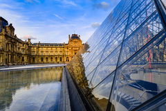 Glass Pyramid and Louvre Museum royalty free stock images
