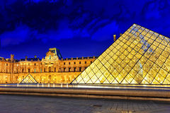 Glass pyramid and the Louvre museum Stock Images