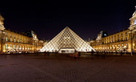 Glass Pyramid of Louvre, Paris at night Stock Photo