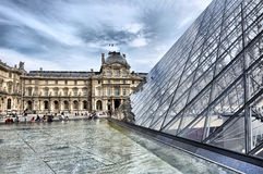 Glass pyramid shaped building, Louvre Royalty Free Stock Photo
