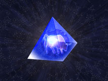 Glass pyramids. New year's oxen inwardly transparent pyramid on background starry sky Stock Photo