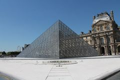 Glass Pyramids Outside of the Louvre, Designed by I.M. Pei. The Glass Pyramids outside of the Louvre, designed by I.M. Pei Royalty Free Stock Photo