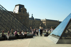 Glass Pyramids and tourists at the Louvre Museum Stock Photo