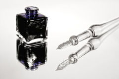 Glass quill and an inkpot Royalty Free Stock Image