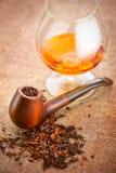 glass rørtobak för cognac Royaltyfria Bilder