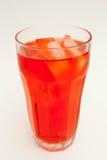 glass rött sodavatten Arkivbild