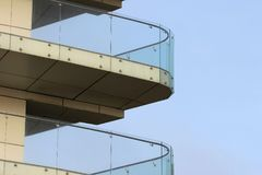 Glass railings on balconies of a new building.  Royalty Free Stock Photo