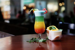 Glass of rainbow cocktail Royalty Free Stock Images