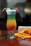 Glass of rainbow cocktail Stock Photos