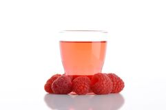 Glass of raspberry flavored water Stock Photos