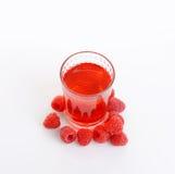 Glass of raspberry juice Stock Image