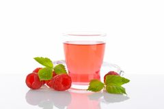 Glass of raspberry juice Royalty Free Stock Image