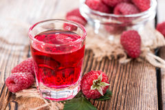 Glass with Raspberry Liqueur. And some fresh fruits Stock Images
