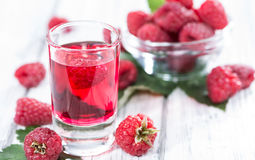Glass with Raspberry Liqueur. And some fresh fruits Royalty Free Stock Image