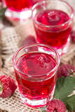 Glass with Raspberry Liqueur. And some fresh fruits Royalty Free Stock Images