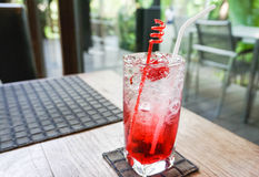 Glass of raspberry soda on table. Glass of raspberry soda in the restaurant Stock Photos